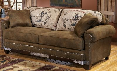 Entertainment Capture a piece of Americas Western history right in your own living room. The exclusively licensed Winchester love seat design includes woven tapestry Winchester Rider fabric; hand-applied, etched- and nailed-metal applique and nail trim, including several Winchester nails. The rich brown, microdenier fabric of this collection gives it the look and feel of leather and provides durability that will last for years. This love seat features: kiln-dried, hardwood frame construction; level-support coil seating; and wrapped, high-resiliency seat cushioning. Plush cushioning surrounds the body of the whole collection. Limited lifetime warranty. Made in USA. 65L x 40D x 39H. Color: Brown. Type: Loveseats. - $1,899.99