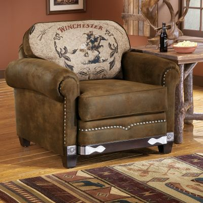 Entertainment Capture a piece of Americas Western history right in your own living room. The exclusively licensed Winchester chair design includes woven tapestry Winchester Rider fabric; hand-applied, etched- and nailed-metal applique and nail trim, including several Winchester nails. The rich brown, microdenier fabric of this collection gives it the look and feel of leather and provides durability that will last for years. This chair features: kiln-dried, hardwood frame construction; level-support coil seating; and wrapped, high-resiliency seat cushioning. Plush cushioning surrounds the body of the whole collection. Limited lifetime warranty. Made in USA. 42L x 40D x 40H. Color: Brown. - $1,499.99