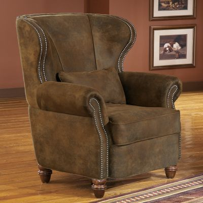Entertainment Capture a piece of Americas Western history right in your own living room. The exclusively licensed Winchester wrap around, sheltered-back design accent chair with 3/8 pewter-nail trim. The rich brown, microdenier fabric gives it the look and feel of leather and provides durability that will last for years. Features include: kiln-dried, hardwood frame construction; level-support coil seating; and wrapped, high-resiliency seat cushioning. Plush cushioning surrounds the body of the whole collection. Limited lifetime warranty. Made in USA. 40L x 41D x 44H. Color: Brown. - $1,299.99