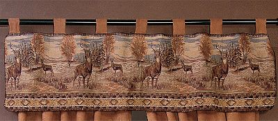 Hunting Tapestry valances have 3 microsuede tabs and outdoor scenes. Tapestry valances are constructed of 52% polyester, 38% cotton, 7% olefin and 3% acrylic. Machine washable or dry-clean. Per each. Made in USA.Size: 55W x 17L.Designs: Elk, Fish and Bear, Horse, Moose and Pine Cones, Whitetail, Great Meadow, White Pine, Lattice Pine Cone, Sutherland Deer, Eclipse Gemstone. Type: Valances. Style Fish/Bear. - $19.88