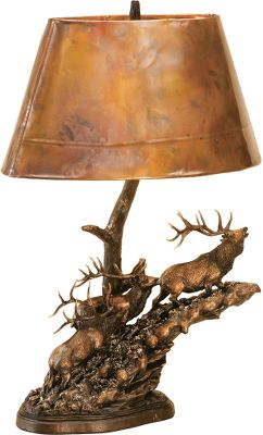 Artist Marc Pierce captures the motion and power of big game on the move. Each scene bathes under the warm glow of an uniquely rustic, genuine-copper shade. The poly-resin sculptures are finished with a natural bronze patina. Accepts a 100-watt bulb (not included). Imported.Available: Living Large 25-1/4H x 11W x 18D Headed High 25-1/4H x 11W x 20D Headed for Home 23H x 11-1/2W x 19-3/4D - $239.99