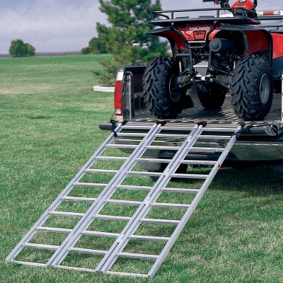 Motorsports Load any four-wheel ATV or lawn tractor into your pickup truck or trailer. The Heavy-Duty Tri-Fold Ramp is constructed of aircraft aluminum with plastic-coated fingers that overlap the tailgate for smooth entry. Extruded side rails with exclusive plywood insert channels allow you to convert ramps to a smooth surface for loading snowmobiles, push mowers and lawn tractors while deterring your ATV from sliding off the edges. Safety straps included. Plywood not included. Imported. Weight: 28 lbs. Measures: 50W x 69-1/4L open; 16-1/2 W folded. Capacity: 1,750 lbs. Available: Heavy Duty, Yutrax Tri-Fold. Type: Loading Ramps. - $109.99