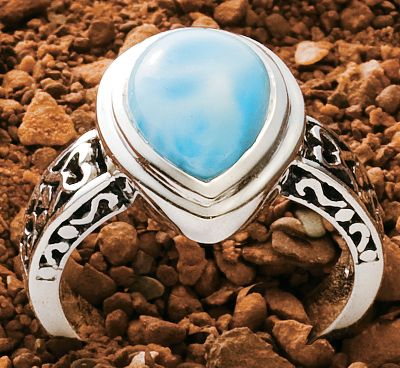 Entertainment Beautifully set, Caribbean-sea-blue larimar is accented with highly polished sterling silver.Heat and pressure from volcanic lava flows crystallized larimar gemstones eons ago, and they went largely undiscovered until 1974 when a Peace Corps volunteer stumbled across a deposit of the brilliant blue stones along a remote Caribbean seashore. Now it's treasured for its rich blue hues and one-of-a-kind look. Filigree on the shank and each side of the stone provide added flair. 8mm x 11mm pear-shaped larimar. Sizes: 6-9. - $43.60