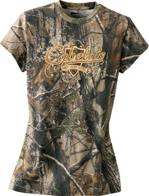 Camp and Hike A comfy 100% cotton camo tee sporting Cabelas fancy logo print on the front. Fun to wear around camp or casual outdoor events. Machine washable. Imported.Womens sizes: S-2XL.Camo pattern: Realtree AP - $9.88