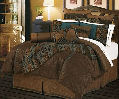 Entertainment Give your bedroom arrangement some charm with beautiful earthtones accented with microsuede and faux leather, and embellished with conchos and fringe. The pillows and comforter are crafted of polyester and filled with polyester fiber to keep you warm and cozy. The bed skirt and sheets are crafted of a smooth polyester and cotton blend. Imported.Sets includes: comforter, two 21 x 27 shams, 18 x 18 cushion and bed skirt.Available: Full (80 x 90 comforter, 18 bedskirt)Queen (96 x 96 comforter, 18 bedskirt)King (110 x 96 comforter, 18 bedskirt) - $339.99