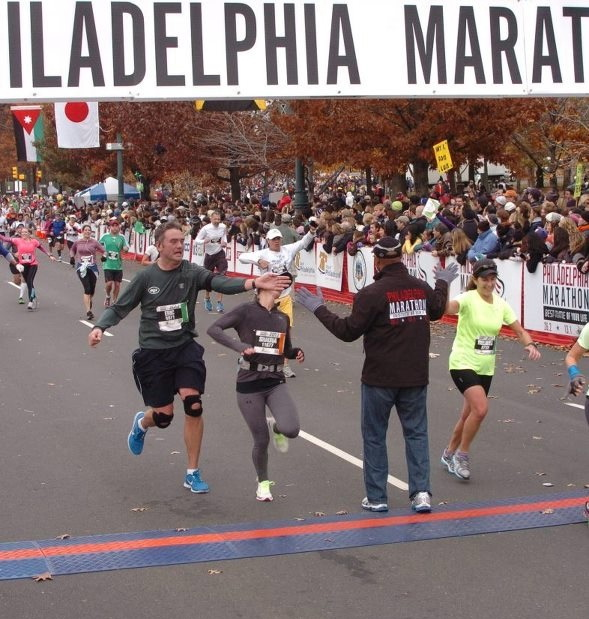 Fitness Guy accidentally punches a woman in the face trying to high five the mayor of Philadelphia after finishing the Philadelphia Marathon (OC)