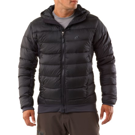 Camp and Hike The adidas Hiking Hybrid Down jacket offers warmth for cold-weather pursuits. So go explore snow-filled landscapes! Climaproof(R) ripstop polyester fabric sheds light wind and rain. Formotion(TM) design lets jacket follow the natural movements of the body. Insulated with quality 600-fill-power goose down for warmth, light weight and compressibility. Hood features drawcord adjustments for a secure fit. Zippered hand pockets. Closeout. - $64.73