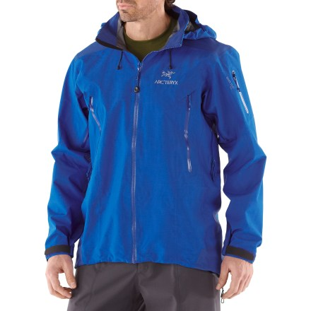 The Arc'teryx Theta AR jacket is a full-featured Gore-Tex(TM) Pro Shell storm shelter with clean styling and multi-sport versatility. Theta AR is the longest length jacket from Arc'teryx and offers maximum coverage; the Drop Hood(TM) with a tall collar provides quick access to head protection. Made from supple Gore-Tex(TM) 3L Pro Shell fabric, Theta AR is completely waterproof and windproof, and offers excellent breathability. Gore Micro Grid lining is a thin, low-denier, low-density woven fabric that allows the shell to slide easily over midlayers. A reduced number and thickness of seams offers improved abrasion- and snag-resistance, enhanced breathability and decreased weight. Helmet-compatible Drop Hood(TM) combines the protection of a high collar with an easy-access, laminated brimmed hood; hood adjusts easily with 1 hand. Watertight front zipper with inner laminated windflap ensures total weatherproofing; laminated quick-dry chin guard protects skin. Features watertight laminated polyurethane exposed pit zippers. Storage options include dual handwarmer pockets and sleeve pocket with laminated zippers. Articulated elbows and no-lift, gusseted underarms ensure a comfortable fit. Dropped rear hem offers full seat coverage and includes adjustable waist and hem drawcords; die-cut, laminated rip-and-stick wrist closures. Athletic fit with slim construction is engineered for performance. - $348.93