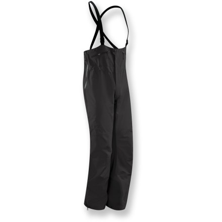 Ski Arc'teryx Theta SV short-length bib pants thrive and protect in harsh weather. They're crafted from robust Gore-Tex(R) Pro Shell fabric for high-performance protection and durability. Waterproof, windproof and breathable; Gore-Tex face fabric offers exceptional durability and full weather protection in a supple, notably soft-to-the-touch textile. Gore micro-grid backer slides easily over mid layers. Reinforced in the knees, lower legs and seat to protect high-wear areas. Microseam allowances and tiny Gore(R) seam tape reduce bulkiness and weight. Low-cut bib with a front fly; rear elastic waist is integrated for comfort and a clean finish. Separating side zippers provide a drop-seat option, without the need to remove suspenders. Watertight 3/4-length leg zippers allow quick venting. Watertight external zippers and zipper garages. Heavy-duty instep patches protect against damage by boots, crampons and ski edges. Powder cuffs with lace hooks fit easily over boots and secure into postion; large pant cuff diameter works well with alpine boots. Hems have cord cinches. 2 stash pockets sport laminated zippers. Articulated knees and gusseted crotch enhance mobility and comfort. Arc'teryx expedition fit is cut slightly roomy to accommodate multiple layers without restricting movement; suitable for winter and extreme weather. - $236.83
