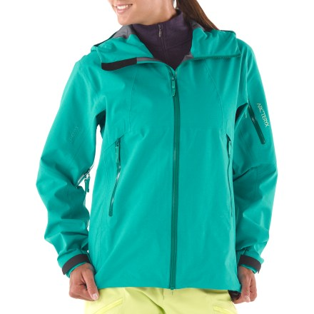 Ski The women's Arc'teryx Scimitar jacket features a lightweight, soft Gore-Tex(R) Pro Shell textile. It's designed for energetic tours in the backcountry or laps on the hill. Rugged Gore-Tex(R) 3L Pro Shell fabric is tough, extremely breathable and durably waterproof and windproof. Reduced quantity and thickness of seams saves weight, provides excellent abrasion- and snag-resistance and enhances breathability. Helmet-compatible Storm Hood(TM) and generous collar protect you in inclement weather without sacrificing your peripheral vision. Front zipper prevents windchill and snow entry; quick-drying chin guard protects soft skin from zipper abrasion. Stretch panel powder skirt with snap closure keeps out cold air and snow; slide-and-lock snaps attach jacket to compatible pants (sold separately). Articulated elbows, roomy underarm gussets and forward-leaning articulation ensure easy movement. Pit zippers allow easy and efficient ventilation; WaterTight(TM) zippers do away with bulky zipper flaps. Handwarmer pockets and sleeve pocket all have waterproof zippers. Arc'teryx Scimitar jacket also features 2 internal laminated pockets. Embedded RECCO(R) reflector enhances radio signals from search-and-rescue RECCO detectors to speed location acquisition in an avalanche. - $275.83