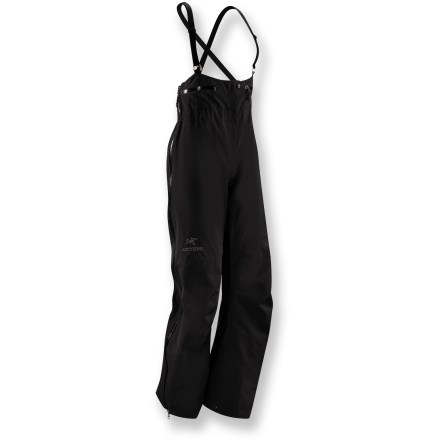 Ski Arc'teryx Theta SV women's bib pants thrive and protect in harsh weather. They're crafted from robust Gore-Tex(R) Pro Shell fabric for high-performance protection and durability. Waterproof, windproof and breathable; Gore-Tex face fabric offers exceptional durability and full weather protection in a supple, notably soft-to-the-touch textile. Gore micro-grid backer slides easily over mid layers. Reinforced in the knees, lower legs and seat to protect high-wear areas. Micro-seam allowances and tiny Gore(R) seam tape reduce bulkiness and weight. Low-cut bib with a front fly; rear elastic waist is integrated for comfort and a clean finish. Separating side zippers provide a drop-seat option, without the need to remove suspenders. Watertight 3/4-length leg zippers allow quick venting. Watertight external zippers and zipper garages. Heavy-duty instep patches protect against damage by boots, crampons and ski edges. Powder cuffs with lace hooks fit easily over boots and secure into position; large pant cuff diameter works well with alpine boots. Hems have cord cinches. 2 stash pockets sport laminated zippers. Articulated knees and gusseted crotch enhance mobility and comfort. Arc'teryx expedition fit is cut slightly roomy to accommodate multiple layers without restricting movement; suitable for winter and extreme weather. - $475.00