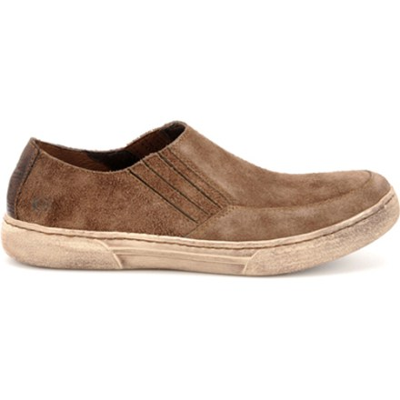 Give your feet a day off in these easy-fitting Born Desmond slip-on shoes that offer the soft flexibility of a deconstructed moccasin. Soft suede leather uppers are weather resistant and very durable. Twin elastic gores adjust to fit both low- and high-volume insteps. Leather linings are soft against bare feet. DRYZ(R) foam footbeds lower foot temperature and absorb moisture, turning it into gel that evaporates when shoes are removed. Handsewn Opanka construction offers flexibility and comfort; contrast stitching adds eye-catching appeal. Plastic shanks provide torsional rigidity. Rubber outsoles provide traction on varied terrain. Closeout. - $50.83