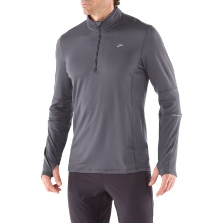 Fitness The men's Brooks Essential Half-Zip II top works hard to keep you comfortable on cool days, and it's perfect under a shell in colder weather. - $15.83