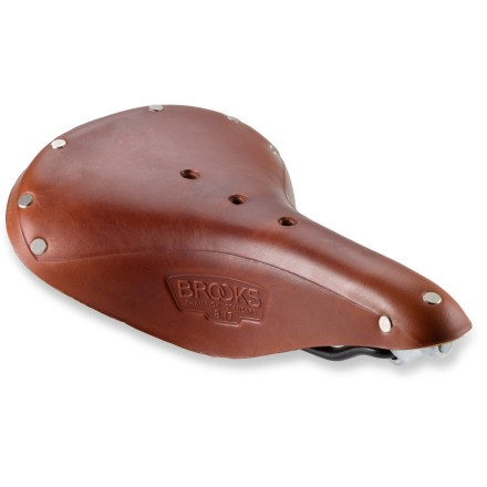 "Fitness The Brooks England flagship B17 flagship saddle has been around for 100 years. It's an excellent choice for touring, century rides, ultra-marathon rides and other demanding cycling. Leather provides natural ""give"" by stretching and flexing, and because it doesn't need padding, it's a cool option in warm weather. Saddle will age and break in over time. Bag loops permit the use of a traditional English-style touring bag on the rear of saddle. - $103.93"