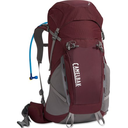 Camp and Hike The CamelBak Vista FT 33 hydration pack for women is perfect for a long day or quick weekend adventure. It provides easy zippered access to the reservoir via the back panel. Spacious main compartment holds food, gear and your 10 essentials for a 1-day peak ascent or an overnight trip. 100 fl. oz. Antidote(TM) reservoir features a welded center baffle and a low-profile shape for stability. Wide mouth makes it easy to fill and clean the reservoir; quick-snap cap tightens in just a quarter turn. Quick Link(TM) system lets you effortlessly add accessories such as a Fresh(TM) filter, insulated tube, tube director, flow meter or hanger (accessories sold separately). Big Bite(TM) valve is ergonomically positioned for easy drinking and stays protected and clean inside the Bite Valve cover. Hydration sleeve holds the reservoir flat against your back to leave more room for layers and gear. Women-specific harness with perforated foam, padded shoulder straps, sternum strap and load-bearing hipbelt provide maximum comfort and even load distribution. Back panel offers great ventilation and a stable center of gravity. Dual V-shaped aluminum stays provide effected load support and weight transfer to the hipbelt. Large stash pocket on the front panel keeps gear close at hand. Side compression straps help stabilize the load; tool loops and lash points let you attach extra gear to the exterior of the pack. The CamelBak Vista FT 33 hydration pack is made from abrasion-resistant ripstop nylon and rugged taffeta for long-lasting wear. Assembled in the U.S. of domestic and foreign components. - $135.93
