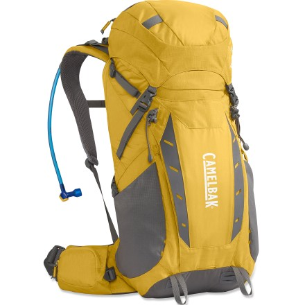Camp and Hike The CamelBak Vantage FT 35 hydration pack helps you stay comfortable and well-watered during a long day or an overnighter. It offers easy zippered access to the reservoir via the back panel. 100 fl. oz. Antidote(TM) reservoir features a welded center baffle and low-profile shape for stability. Quick Link(TM) system lets you effortlessly add accessories such as a Fresh(TM) filter, insulated tube, tube director, flow meter or hanger (accessories sold separately). Hydration compartment loads easily, holding the reservoir flat against your back to leave more room for layers and gear. Wide-mouth port cuts weight and makes it easy to fill and clean the reservoir; quick-snap cap tightens in just a quarter turn. Folding arms lock into position to hold the reservoir open when drying; arms tuck out of the way around the port when not in use. Big Bite(TM) valve is ergonomically positioned for easy drinking. Reservoir does not retain tastes or odors and is easy to clean and fill via the large, 3.5-in. opening. PureFlow(TM) delivery tube makes every gulp taste clean, not like plastic. With its separate zippered opening, the reservoir can be easily refilled without removing it from the pack; insulated reservoir pocket keeps your water cool for hours. Padded shoulder straps, sternum strap and load-bearing hipbelt provide maximum comfort and even load distribution. Back panel offers ventilation and a stable center of gravity; dual V-shaped aluminum stays provide support and transfer load weight to the hipbelt. Main compartment holds food, gear and your 10 essentials for a 1-day peak ascent or an overnight trip. Zippered lid pocket keeps electronics, cell phone and other valuables close at hand. Side compression straps help stabilize the load; tool loops and lash points let you attach extra gear on the outside. Side stretch pockets, front stash pocket and internal organizer pocket store hiking essentials. - $134.93