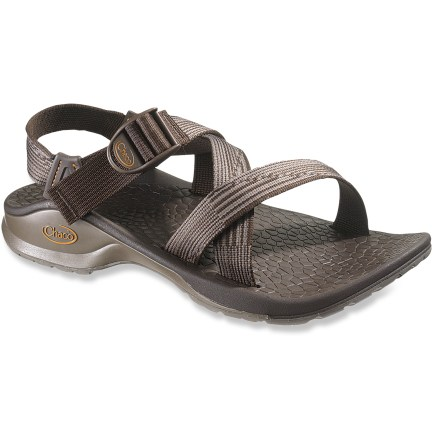 Entertainment Chaco Updraft Bulloo men's sandals keep feet comfortable and supported throughout active pursuits. Adjustable polyester strapping system uses pull-through design to give you a secure fit while avoiding the bulkiness of extra buckles and straps. Polyester webbing dries faster than nylon, maintaining a uniform fit in all conditions. Sculpted XO3 LUVSEAT(TM) platform offers 20% weight savings over traditional Chaco sandals without sacrificing the reliable arch support. Shaped polyurethane footbeds/midsoles boast thermoplastic urethane frames to deliver ergonomic support for an especially lightweight fit. Vibram(R) Bulloo rubber outsoles offer slip-resistant performance. All-synthetic construction makes these Chaco Updraft Bulloo sandals vegan friendly. Closeout. - $52.73