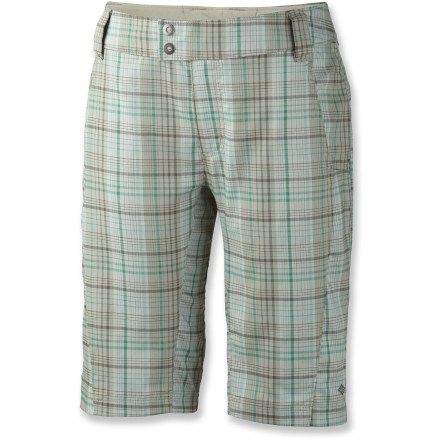 Camp and Hike Stylish and functional, the lightweight Columbia Saturday Trail Stretch plaid shorts look great on the trail or along the oceanside boardwalk. Stretchy, durable and breathable polyester/cotton fabric is treated with Omni-Wick(R) treatment to absorb and disperse excess moisture. Fabric provides UPF 15 sun protection, shielding skin from harmful ultraviolet rays. Saturday Trail Stretch plaid shorts have hand pockets with mesh linings and 1 zippered security pocket on right thigh. Slim fit and mid-rise waist. - $37.93