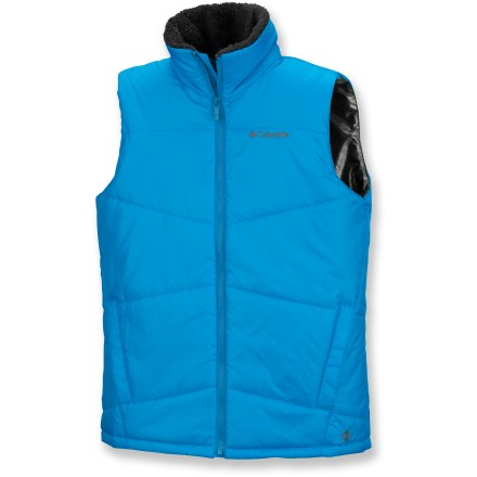 The Columbia Heat Excursion vest keeps a boy's core warm when a jacket is too much. Polyester outer fabric and lining is soft and comfortable; Omni-Heat(R) thermal reflectivity and polyester insulation ensure exceptional warmth. Fabric is treated with Omni-Shield(R) for water repellency. Sherpa fleece at collar for comfort and warmth. Internal security pocket and media pocket. Handwarmer pockets round out features. Closeout. - $14.73