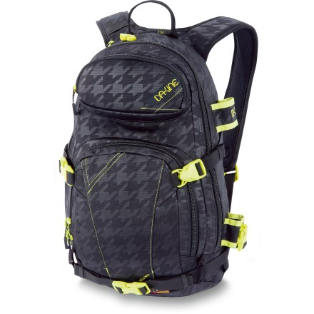 Ski The DAKINE Heli-Pro 18L pack does it all, from steep chutes to backcountry explorations to hanging around town. Snug-fitting design keeps the weight close to your body for balance on uneven terrain and ease on chairlifts. Straps let you carry your snowboard vertically in a stable, secure manner on the trek to the top. Retractable cable carrying straps hold alpine or backcountry skis; side holster secures your shovel handle or ice axe. Integrated load compression straps steamline pack and keep bulkiness down. Fleece-lined goggles pocket protects your lenses from getting scratched when not in use. Internal slab pocket with exit port carries a water reservoir (not included) for easy hydration on the go. Zippered organizer pocket offers individual sleeves to stash your phone, camera and pens. Non-padded interior sleeve fits most 14 in. laptops when off the slopes. 600-denier polyester fabric is lightweight, durable and water resistant. DAKINE Heli-Pro 18L pack features a padded hipbelt and a harness contoured to comfortably fit a woman's frame. Closeout. - $58.93