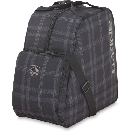 Ski The DAKINE Boot Bag conveniently fits either a pair of ski or snowboard boots for easy, secure transport. Zippered front pocket stashes small essentials such as socks or toe heaters. Top haul handles and an adjustable shoulder strap make it easy to transport the DAKINE Boot Bag. - $31.93