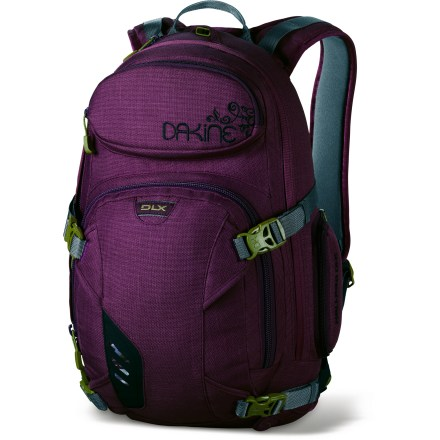 Ski Carry a snowboard and a day's worth of gear with the DAKINE Heli-Pro DLX 18L women's daypack . Plus, it's slim enough to wear on a chairlift! Snug-fitting design keeps the weight close to your body for balance on uneven terrain and ease on chairlifts. 600-denier polyester fabric is lightweight, durable and water resistant. Straps let you securely carry your snowboard vertically or horizontally-whichever you prefer. Retractable cable carrying straps hold alpine or backcountry skis. Quick-draw ice axe sleeve and external shovel pocket offer space to pack your backcountry essentials. Integrated load compression straps steamline pack and keep bulkiness down. Insulated compartment for hydration reservoir (not included) and insulated shoulder pads prevent frozen hose, ensuring convenient and reliable hydration. Fleece-lined goggles pocket protects your lenses from getting scratched when not in use. DAKINE Heli-Pro DLX 18L pack features a padded hipbelt and a harness contoured to comfortably fit a woman's frame; sternum strap buckle doubles as a rescue whistle. Closeout. - $72.93
