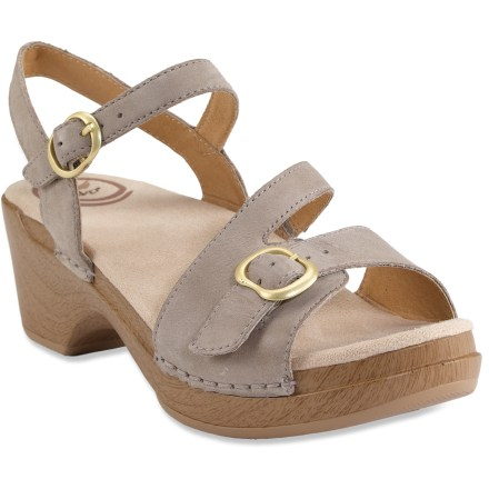 Entertainment These Dansko Sandi sandals leverage the strength and support of traditional Dansko clogs in a soft, lightweight sandal alternative. Smooth leather straps wrap around ankles for a comfortable fit. Supple leather linings are oh-so-comfortable against skin. Open-cell foam footbeds with soft Dri-Lex(R) polyester topsoles transfer moisture, dry quickly and resist odors. Medium-density polyurethane midsoles with EVA forefoot inserts provide shock absorption, flexibility and rebound; EVA reduces weight and enhances comfort. Nylon shanks enhance stability and support underfoot. Polyurethane outsoles offer versatile traction; beveled heels ensure stability, and rockered forefoot area propels feet forward when walking. Coring holes and cored out forefoot reduce overall weight of the sandals without sacrificing support. Dansko Sandi sandals proudly carry the Seal of Acceptance from the American Podiatric Medical Association. - $79.93