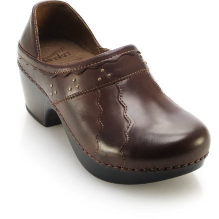 With great texture and style, the Dansko Hailey clogs offer any-day versatility along with plenty of support and comfort. Soft, burnished full-grain leather uppers feature hand-crafted patterns that can go from the office to the patio with ease. Leather linings are smooth and soft; pigskin-wrapped footbeds feature dual-density EVA and memory foam cushioning for excellent comfort underfoot. Contoured midsoles use recycled polyurethane to offer shock absorption and comfort for all-day wear. Steel shank supports within the midsole allow heel-to-toe flexibility and side-to-side stability, reducing torque and overpronation. Polyurethane outsoles on the Dansko Hailey clogs feature 2 1/4 in. tall heels and rockered forefoot area to supply stability and easy walking. - $97.93
