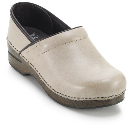 With supple leather construction and famed comfort, the Dansko Professional Soft full-grain leather clogs are great for those on their feet all day, from the office to overseas travel. Soft full-grain leather uppers are smooth and water-resistant for lasting wear, even in wet conditions or around acidic or greasy environments. To clean, simply wipe the uppers with a damp cloth. Leather uppers are stapled to the bases for a durable, secure fit. Antimicrobial leather linings help deter odor development. Sturdy polyurethane toe boxes protect feet from bumps and enhance durability without compromising toe space. Contoured midsoles offer firm arch support and superior shock absorption for long-lasting, on-your-feet support. Rocker-bottom outsoles support your natural heel-to-toe transition for all-day wear and comfort, and provide superior slip resistance. Dansko Professional Soft clogs carry the Seal of Acceptance from the American Podiatric Medical Association. A good Dansko fit should allow heels to move up and down freely, and provide ample wiggle room for your toes. - $56.83