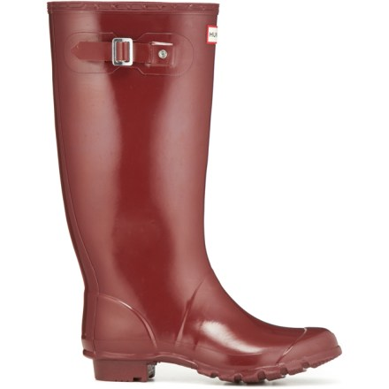 These Hunter Huntress Gloss rain boots offer a timeless look, waterproof protection and a roomy fit for all your wet weather needs. Waterproof, vulcanized natural rubber uppers are flexible and offer a convenient slip-on design; classic buckles let you adjust the fit. Slightly wider calf circumference and shorter shaft height offer a touch more room for those looking for a roomier rain boot. Nylon linings wick moisture and dry quickly to help keep your feet dry and comfortable. Multilayered sponge insoles and rubber midsoles ensure cushioning underfoot. Rubber outsoles on the Hunter Huntress Gloss rain boots feature a short heel and lugged tread for traction and durability. - $140.00