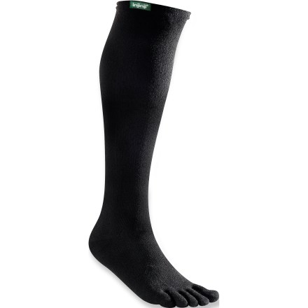 The Injinji Original Over-the-Calf toe socks are a great choice for travel. They go on easy and keep feet comfortable while exploring new environments. NuWool fabric is moisture wicking and quick drying. Nylon adds durability and Lycra(R) spandex offers stretch and shape retention. Built with AIS:technology(TM) (Anatomical Interface System) for free movement from your heel to each of your five toes. AIS:technology separates toes with a thin, antifriction membrane, encouraging circulation and eliminating skin-on-skin contact that leads to blisters. Precisely stitched Vector Heel prevents bunching and allows a comfortable fit. Double-layer welt top maintains shape for long-lasting performance and support. Closeout. - $6.83