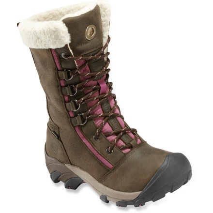 Camp and Hike Supplying stout winter protection, the Keen Hoodoo High Lace women's winter boots are a solid choice for winter wanderings or clearing the driveway. Full-grain leather uppers not only look great but withstand harsh conditions; lacing system supplies a snug, secure fit without much fuss. KEEN.DRY(TM) waterproof, breathable membranes keep feet dry while dissipating moisture inside the boots. 200g KEEN.WARM(TM) insulation uses a mix of charcoaled bamboo and polyester fibers to ensure warmth and comfort in chilly conditions. Faux shearling linings wick moisture and improve thermal regulation; linings are rolled over at top for comfort and a touch of classic style. Injection-molded EVA midsoles topped with removable EVA footbeds offer shock absorption and padding for all-day comfort. Nylon shanks enhance support and stability for handling changing terrain. S3 (shock, suspension, stability) heel support structure supports the feet on impact, dissipates shock and reduces the chance of twisting an ankle. Toe caps help protect boots and feet from bumps and abrasion. Nonmarking rubber outsoles on the Keen Hoodoo High Lace boots boast multidirectional lugs to enhance traction. Fit tip: runs about a 1/2 size small. - $69.83