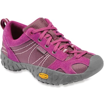 Great for the day-to-day adventures, the Keen Ambler girls' shoes supply a versatile, lightweight design for ambling about. Suede leather and nylon mesh uppers are durable, flexible and breathable for comfort on the go. Laces supply a personalized fit; heel loops aid entry and exit. Nylon mesh linings wick sweat away from feet to keep them comfortable. Lightweight EVA midsoles offer shock absorption and cushioning for all-day comfort. Nonmarking rubber outsoles on the girls' Keen Ambler shoes deliver good traction on a variety of surfaces. - $37.93