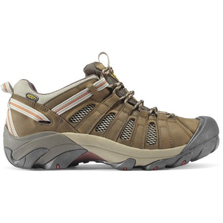 Camp and Hike Keen Voyageur hiking shoes supply lightweight, cushioned performance. Hit the trail in comfort. Leather uppers with polyester mesh ventilation panels offer durability, flexibility and breathability for comfort on the go. Polyester linings wick moisture away from your feet and dry quickly to keep feet comfortable and dry. Webbing pull loops at heels and tongues allow easy entry/exit. Patented rubber toe bumpers protect feet and uppers from bumps and abrasion. Removable EVA footbeds are shaped to provide ample cushioning and arch support; can also accommodate orthotics. Compression-molded EVA midsoles offer shock absorption and padding for all-day comfort. Nylon shanks provide torsional stability and protection from uneven and rocky terrain. S3 (shock, suspension, stability) heel support structure supports the feet on impact, dissipates shock and helps reduce the chance of twisting an ankle. Keen Voyageur hiking shoes feature nonmarking carbon rubber outsoles with aggressive 4mm multidirectional lugs for durability and superb terrain bite. Closeout. - $43.73