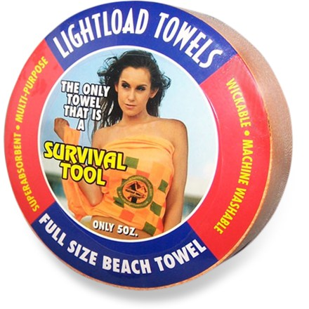 Camp and Hike The Lightload Towels beach towel features unique packaging that compresses it to the size of a hockey puck! Keep a spare towel in your glove box or backpack. - $4.93