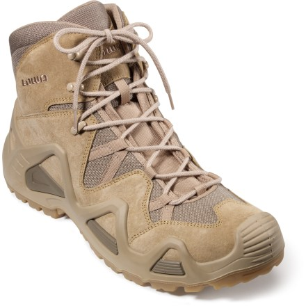 "Camp and Hike Designed for use in the desert and other hot, dry climates, the Lowa Zephyr Desert Mid hiking boots are lightweight, highly breathable and supportive for light-hiking adventures. Split-grain leather and nylon mesh uppers deliver durability and high breathability; external polyurethane frames offer support and reduce need for extra internal padding. Polyester mesh linings wick moisture away from your feet to keep them dry and comfortable. Padded ankles and tongues relieve pressure and add comfort; removable footbeds add light cushioning and support underfoot. Polyurethane midsoles offer outstanding cushioning for all-day wear; 3/4-length nylon shanks afford enhanced torsional rigidity to protect and support feet. Lowa ""Cross"" rubber outsoles deliver excellent traction on all types of terrain. - $125.93"