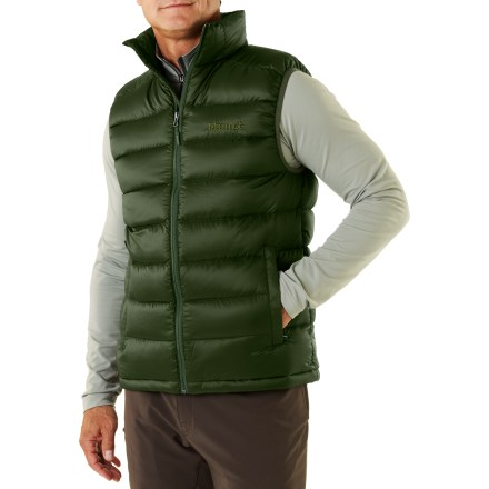 The Marmot Zeus vest is a great way to stock up on warmth without bulking up your pack or your layers. Water-resistant, ultralight downproof ripstop shell surrounds premium 800-fill-power goose down; Durable Water Resistant finish repels moisture and stains. Draft flap behind front zipper keeps breezes out; chin guard protects from abrasion. Features a drawcord hem and zippered handwarmer pockets; left pocket doubles as a stuff sack. - $74.83