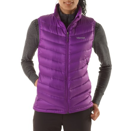 The Marmot Jena vest offers highly compressible, down-filled warmth. You'll certainly wear it alone, but its slim profile makes it the perfect mid layer in truly cold conditions. - $36.83
