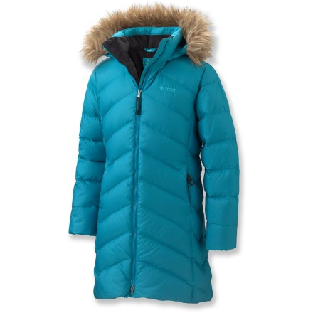 Ski The Marmot Montreaux down coat for girls offers distinctive, urban-chic lines and feminine details that beautifully disguise serious insulation. Warm and compressible 650-fill-power goose down is surrounded by a soft polyester shell and lining. Attached hood features removable faux fur trim. 2-way front zipper features inner and outer stormflaps. Handwarmer pockets are lined with plush fleece. The Marmot Montreaux down coat features a long length that offers abundant warmth. - $165.00