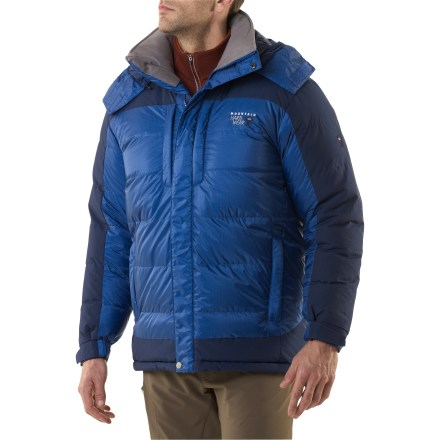 Cold-weather backcountry expeditions call for this essential piece of gear. The men's Mountain Hardwear Chillwave down jacket ensures your warmth with goose down fill and windproof construction. Lofty 650-fill-power goose down has a high warmth-to-weight ratio; baffles keep down in place and ensure maximum loft and warmth. AirShield(TM) technology: a windproof membrane sandwiched inside keeps the wind out but lets your body breathe easily when you're working aerobically. Although not waterproof, the fabric and membrane work together to repel moisture to keep the down from getting wet. Shell fabric is soft and quiet; high-wear areas are reinforced to resist abrasion. Detachable, insulated hood adds versatility to the Chillwave jacket; hood secures over lower face with rip-and-stick closures and 1-handed drawcords make quick fit adjustments. Tall insulated collar is lined with soft, wicking Micro-Chamois(TM) fabric. Insulated stormflap, elastic and rip-and-stick-adjustable cuffs and hem drawcords hold warmth inside. Zip handwarmer pockets, 2 zip chest pockets and interior zip-secure pocket. Mountain Hardwear Chillwave jacket comes with a stuff sack. - $375.00