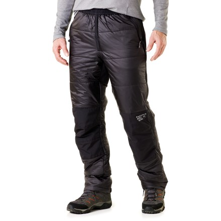 The Mountain Hardwear Compressor pants are lightweight and highly compressible. These insulated overpants have a reinforced seat and knees for durability in ice and snow. Thermic Micro synthetic insulation is lofty, warm and compressible. Thermally bonded short staple fibers compress tight and spring back fast; they're produced in a single sheet of consistently dense insulation to eliminate cold spots. Adjustable elastic waist provides a personalized fit; front fly zipper. Full-length side zippers offer quick ventilation and no-hassle on and off; rip-and-stick tabs at cuffs. Reinforced seat and knees protect against abrasion. Mountain Hardwear Compressor pants have 2 zip hand pockets. - $86.83