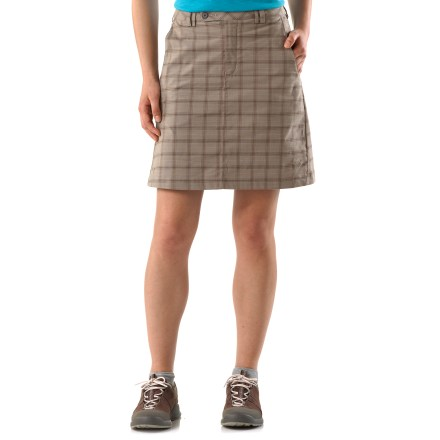 The Mountain Hardwear Around Townie skirt is lightweight, comfortable and quicker drying. Enigma Plaid(TM) combines the comfort of cotton with the fast drying times of polyester; some stretch is added to enhance easy motion, and fabric is washed for softness. Dri-release(R) waistband lining wicks moisture; zip fly, button closure and belt loops. Around Townie skirt include 2 hand pockets. Closeout. - $15.73