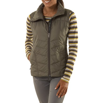 With curvaceous lines and an intelligent design, the versatile Nau Check Down vest provides core warmth without the bulk. This minimalist vest is crafted for women who travel well and travel often. Recycled ripstop polyester shell is downproof, keeping feathers on the inside and snags at bay; recycled polyester is crafted from post-consumer PET bottles. Critical for core warmth in colder temps, the luxurious 800-fill-power goose down vest weighs in at a mere 7.7 oz., so it works hard without the bulk. Fabric is treated with a Durable Water Repellent finish to repel moisture and stains. With 2 concealed pockets, an off-set zip and subtle check pattern, the hushed Nau Check Down vest has a whispered power to it. Regular fit is no too tight and not too loose, it's just right. - $107.93