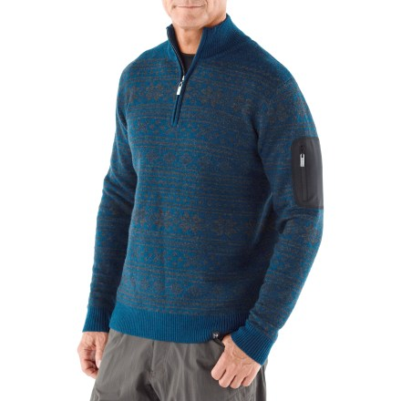 The Neve Carson Quarter-Zip sweater has an intricate Nordic pattern that brings style to your winter activities. Made of soft merino wool, this sweater insulates, wicks away moisture and breathes-naturally. Zippered pocket on the left sleeve adds convenience. Hand wash in cold water and lay flat to dry. - $49.83