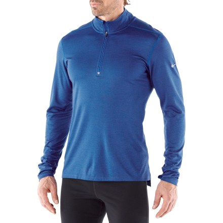 Fitness Combining the moisture-wicking properties of polyester and the warmth of wool, the Nike Wool half-zip running top helps keep you comfortable in a wide range of temperatures. Special mix of Dri-FIT(R) polyester and wool fabric offers moisture-wicking comfort and helps retain heat in cool temperatures. Zipper offers instant ventilation, and cuffs with thumbholes help keep wrists warm. Reflective highlights increase visibility in dim light, and a reflective loop at center back corrals your earphone cord. Dropped hem increases coverage during activity. Flatlock seams and raglan sleeves reduce chafing and enhance freedom of motion. The Nike Wool half-zip running top is machine washable. - $58.93