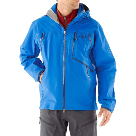 Ski Reduce your layers with the Outdoor Research Vanguard shell jacket that features fleece-backed Gore-Tex(R) soft-shell fabric. Jacket is built for sidecountry skiing across a wide range of climates. 3-layer Gore-Tex(R) soft shell provides breathable waterproof protection from the elements, while maintaining a gentle feel. Fully taped seams prevent water from penetrating through seams. Polyester fleece lining adds a touch of warmth and wicks moisture so your skin doesn't get clammy. Articulated sleeves are designed to move with the body, increasing comfort and range of motion. Fully adjustable, helmet-compatible, removable hood protects you in inclement weather. Removable powder skirt keeps out cold air and snow; rip-and-stick cuffs and adjustable drawcord hem help to keep cold out and warmth in. Zippered handwarmer pockets and a zippered Napoleon pocket with media/headphones port. Interior pockets include a zippered pocket with media/headphones port, lift pass pocket with key clip and 2 large shove-it pockets. Chest-to-hip zip vents allow temperature regulation and quick access to interior pockets without fully unzipping jacket. Embedded RECCO(R) reflector enhances radio signals from search-and-rescue RECCO detectors to speed location acquisition in an avalanche. - $296.83
