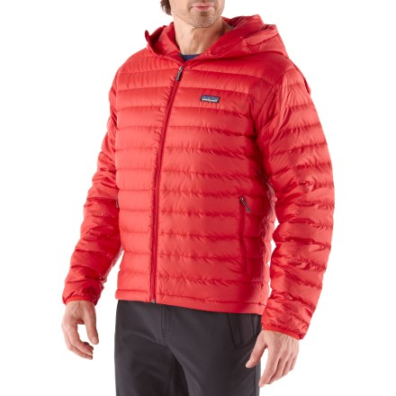 The Patagonia Down Sweater full-zip hoodie is an ultralight, highly compressible down insulation piece or can serve as outerwear for cold mountain pursuits. Features 800-fill-power down, stabilized through a quilted construction and protected by a superlight but tough, windproof and water-resistant recycled polyester shell. Treated with a Durable Water Repellent finish for water resistance and quick drying. Nylon-bound elastic cuffs and drawcord hem. Zip handwarmer pockets; internal zip stretch-mesh pocket doubles as a stuff sack and has a carabiner clip-in loop. Neither slim nor oversize; regular-fitting technical garments may be worn over heavier midlayers. - $269.00