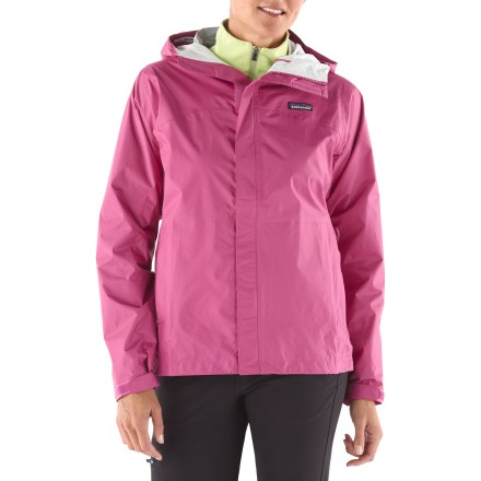 From the perpetual drip of a rain forest trek, to the flash-bang of an afternoon thunderstorm in the mountains, the women's new Patagonia Torrentshell jacket is built to protect in bad conditions. H2No waterproof breathable barrier maximizes protection in very wet conditions; it blocks wind and water on the outside yet allows perspiration to esacpe. Torrentshell keeps the wearer warm, dry and comfortable. 2-way adjustable hood with laminated brim rolls down and stows away; microfleece-lined neck and chin enhance comfort and protection. Full-length front zipper features both and interior and exterior stormflaps. Pit zips include stormflaps and water-resistant zippers. Drawcord hem and self-fabric rip-and-stick cuff closures. Handwarmer pockets; packs into zippered self-storage pocket. Regular fit. - $89.93