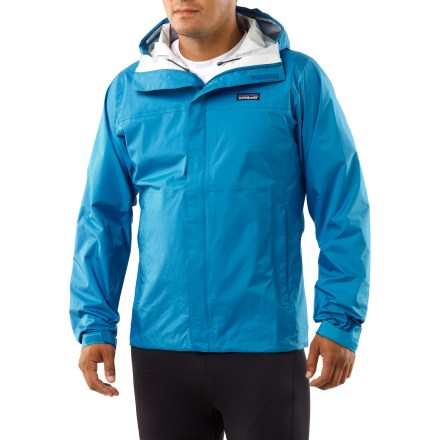 From the perpetual drip of a rain forest trek, to the flash and bang of an alpine afternoon thunderstorm, the new Patagonia Torrentshell jacket is built to protect in rough conditions. The Torrentshell helps keep the wearer warm, dry and comfortable. H2No(R) waterproof breathable barrier provides maximum protection in wet conditions; it blocks wind and water on the outside yet allows perspiration to escape. 2-way adjustable hood with laminated brim rolls down and stows when not in use; microfleece-lined neck and chin for comfort and enhanced protection. Full-length front zipper features both and interior and exterior storm flaps. Pit zips with storm flaps and water-resistant zippers. Drawcord hem and self-fabric rip-and-stick cuff closures. Handwarmer pockets; packs into zippered self-storage pocket. Regular fit. - $89.93