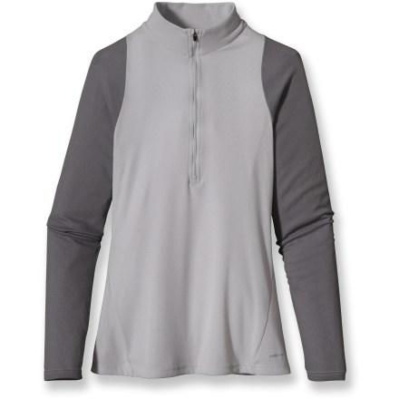 Ideally suited as a first layer for high-endurance activities in a wide range of temperatures, the Patagonia Capilene(R) 2 long-sleeve Zip-T is highly breathable and dries quickly. Patagonia has reinvented its Capilene performance base layers, making them from recycled and recyclable synthetic fiber. Lightweight, open-knit polyester fabric invites airflow, dries quickly and works well when layering; fabric features high recycled content. Gladiodor(R) natural odor control employs benign amino acids to help keep funky scents at bay; plus, it's nonpolluting, safe and durable. Raglan sleeves eliminate shoulder seams, enhancing range of motion and comfort under pack straps. Flat-ribbed underarm and side panels are extra soft for chafe-free comfort where arms are most active next to fabric. Flatseam construction is soft and non-chafing next to skin. Zipper is backed by a draft flap and tucks neatly into zipper garage. Contoured, slim fit minimizes bulk to create an easy-layering garment that won't restrict your movement. Hem length appropriate when left untucked. 100% recyclable through Patagonia's Common Threads Recycling Program-simply return your worn out item to Patagonia. - $23.83